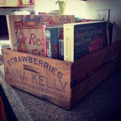 Repurpose old fruit crates for cookbook storage.