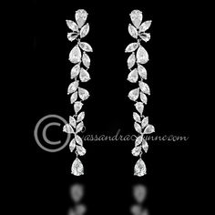 Elegant and gorgeous earrings with marquise and teardrop CZ jewels. Pierced post backs and 3.25 inches long. Rhodium plated, grade AAA cubic zirconia and lead free.