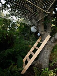 A trapeze-style net, accessible by ladder and tree, offer an unusual interpretation of a treehouse or hammock, as seen on The Outdoor Room by Jamie Durie on HGTV.