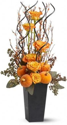 Halloween/Fall flower arrangement. Get flowers at www.flowerexplosi...