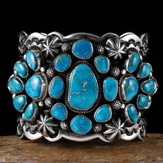 A-DELBERT-GORDON-GEM-Kingman-Turquoise-Bracelet-Sterling-Silver-Navajo.   [Click on image to go to website - MUST see the silverwork on the sides of these cuffs - BEAUTIFUL!]