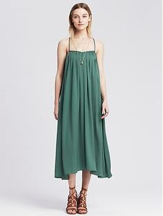 Opt for color this spring with the trapeze dress in teal from Banana Republic.