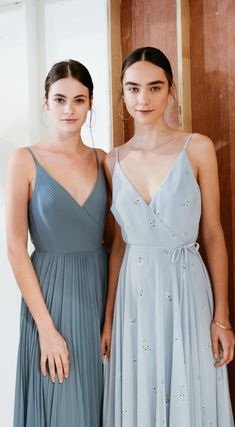 NEW Spring 2019 bridesmaids by Jenny Yoo! This bridal party collection is all about refined sophistication, soft textures & captivating cuts. This versatile collection perfect for any fall, winter, or spring wedding! Each fabric/style dress is available in many colors including hues of blue, burgundy, rose, blush/pink, and champagne/nude! These dresses are long, romantic & can be mismatched. Shown is Kimi and James Print. Photos by Marcy Castelgrande.