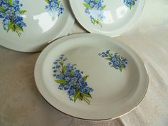 Four exquisite vintage forget me not side plates