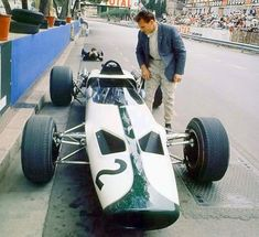 Bruce McLaren looking pretty chilled at this stage of the '66 Monaco weekend upon his teams GP debut, color of the car a function of doing a deal with John Frankenheimer's crew as part of  filming of 'Grand Prix' .  #McLaren #McLarenMonday