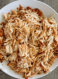 Crockpot Chicken Taco Meat, this stuff is amazing with lots of pico and guac in a warm tortilla.