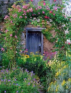 Lush and colorful perennials can be used in a front yard.you don't always have to use evergreen shrubs. And an arbor can add lots of charm. Garden Doors, Garden Gates, Garden Arbor, Secret Garden Door, Garden Trellis, Beautiful Gardens, Beautiful Flowers, English Country Gardens, Covered Pergola