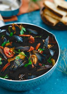 These chorizo chili mussels are an easy, one pot meal made in 20 minutes with spicy dried chilis, fennel and chorizo in a chunky tomato broth. Serve with some warm crusty bread for a seafood feast!