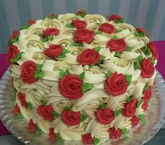 A beautiful cake it reminds me of one of my birthday cakes I had as a child. I loved the Rose decorated ones.