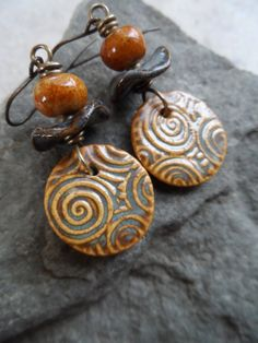 Mesmerize ... Ceramic and Brass Wire-Wrapped by juliethelen