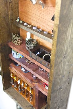 Wall mounted Jewelry organizer made from upcycled wood.... Handmade By TangleandFold. $200.00, via Etsy.