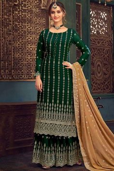 Featuring beautiful embroidery, this bottle green georgette sharara suit which will make you ready to make a statement in the upcoming occassion. This round neck and full sleeve attire accentuated with zari and stone work. Paired with georgette sharara pants in bottle green color with beige georgette dupatta. Sharara pants has zari work. Dupatta also highlighted with zari work. #shararasuits #malaysia #Indianwear #weddingwear #andaazfashion Sharara Suit, Salwar Kameez, Indian Attire, Indian Wear, Plus Size Lehenga, Plazzo Suits, Pant Suits, Pantalon Cigarette, Georgette Fabric
