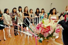 Great bouquet toss idea! All the girls get a ribbon and the bride drops the bouquet and the girl with the ribbon attached to the bouquet gets it!