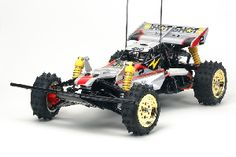 The Tamiya R/C Super Hotshot 2012 Model Kit is a 1/10 scale racing buggy in the Tamiya radio control rc buggy collection.    The Super Shot, which was originally released in 1986 is now available again as the re-named Super Hotshot.