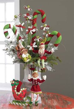 Centerpiece featuring large candy canes and elves