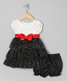 Dressing to the nines will be quite the fuss-free affair when this fancy frock is invited to the party. Aside from the puff-sleeve silhouette, it also boasts tiers of shimmering fabric and a glossy bow accent front and center.  Note: Only infant sizes include bloomers.