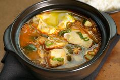 Kimchi Soft Tofu Stew (Soondubu Jjigae). A good guideline. I sliced up some ribeye, sautéed and added to this dish. Also tossed in some anchovy fish sauce, subbed a small dollop of doenjang for the soy sauce and included healthy bit of gochujang.