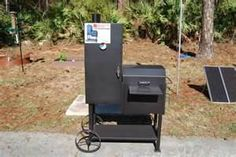 MY OLD COUNTRY PIT,OFFSET VERTICAL CHARCOAL SMOKER,has sliding racks and sausage bars