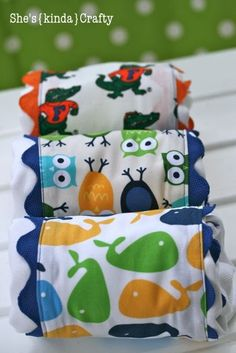 Baby Burp Cloths  The most difficult part of these was the ric rac. If it's not big enough, you will need to hand stitch it to the fabric every couple bumps to keep it connected when you sew the fabric to the burp rag