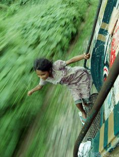 Bangladesh Girl Rides a Train   photo by Tab Tuhin. (677×900)