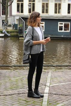 white t-shirt, cropped cardigan, shoulder bag, skinny jeans, and black ankle boots: