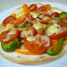 "California Tortilla Pizzas | ""Tortillas make the convenient crust for these crispy personal pizzas topped with fresh vegetables and cheese."""