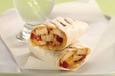 Chicken breasts are tossed with Italian dressing, chopped tomatoes and cheese and then wrapped in tortillas in this easy recipe for the grill.