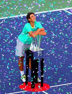Pictures of the Year - Rafael Nadal smiles and hugs his trophy as the confetti rains down on him at the Indian Wells Tennis Garden on March 17. Nadal rallied after losing the first set and trailing 1-3 in the second to defeat Juan Martin Del Potro 4-6, 6-3, 6-4 in the final at the BNP Paribas Open. The title was the Spaniard's third in four tournaments since returning from a seven-month layoff due to injury.