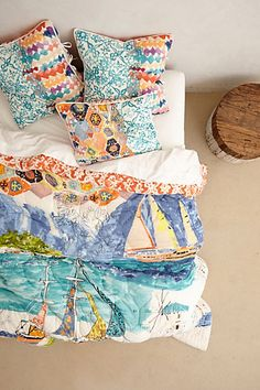 Port of Call Quilt #anthropologie Love the colors. Would buy this but it's not machine washable!!!???