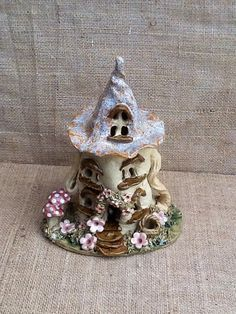 Etsy listing at https://www.etsy.com/listing/185670072/witch-house-tea-light-holder-ceramic