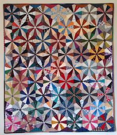 Hollyhock Quilts.The pattern appears to shift when she rotates the blocks - sometimes the lights meet up and then other times the darks meet up.
