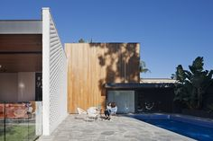 Bagged brick walls and a sculptural use of timber typify the use of raw yet restrained materials that make up Kate's House by . Photo by Crazy Paving, Alfresco Area, Australian Architecture, Bbq Area, Facade House, My House, Landscaping, Houses, Exterior