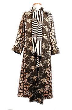 Just had a woman come in who saw this coat and scarf combo and bought it right off the rack. It's a chic way to stay warm AND show a little personality! For your own black and white style stop by the shop or visit our website @ www.thejoannajohncollection.com