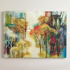 """Painted exclusively for World Market, Sandy Clark's """"Misty Morning"""" depicts a lush landscape of trees amidst the hazy break of dawn. Known for her abstract interpretations of nature, the California artist uses water-based media and untraditional techniques to create her stunning, richly hued pieces."""