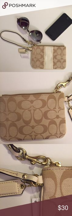 NWT Coach Corner Zip Wristlet in Signature Fabric This NWT Coach Corner Zip Wristlet is crafted with a refined texture and hand-finished leather trim. It's a minimalist piece which carries cards, cash, and a phone in its secure, zip-top design. Applied gold hardware and a dogleash clip on the strap finish it with signature Coach style. • Signature fabric • One credit card pocket • Zip closure, pink fabric lining • Strap with clip to form a wrist strap or attach to the inside of a bag •…