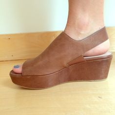Stuart Weitzman Brown Offset Wedge Incredibly comfortable, low platform wedge sandal. Only worn once!!! Sold out everywhere online. Great for being on foot all day! Frye Shoes Wedges