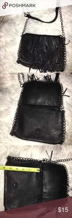 Black Fringe Pocketbook with silver/black Metal Brand New Black Pocketbook with Fringe on the outside and metal chain around Pocketbook and strap. 1 small zippered pocket on the inside back of Pocketbook. Length 6 inches approximately/Width 8.5 inches approximately. Strap is approximately 28 inches long. Strap can come off, it unclips. Bags Shoulder Bags
