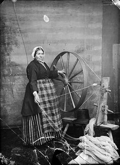 Woman At Spinning Wheel, The source of this file is http://www.llgc.org.uk. National Library of Wales.