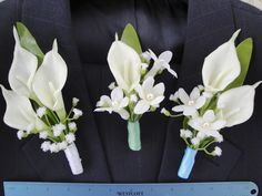 Boutonnières to go with bridal bouquet.