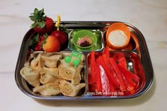 Gyoza, sliced bell peppers, gummy vitamins, strawberries, ranch