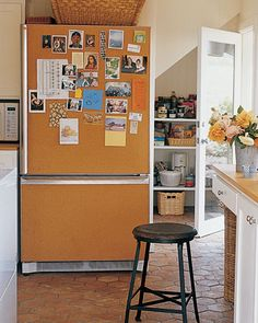 A corkboard-covered refrigerator