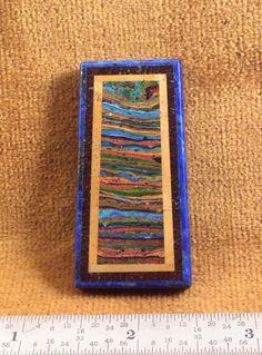 Intarsia of rainbow cal silica with picture jasper, Dino bone, lapis.