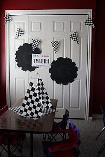 Cheap table cloth turned bunting, poster board tires, customized bday boy license plate