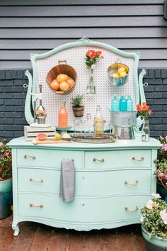 Before you put an old dresser or console on the curb, consider giving it new life as a hard-working piece of outdoor furniture. A fresh coat of exterior paint, new rope pulls and affordable pegboard transformed this castoff into the perfect spot for mixing up a cocktail or potting spring florals. Get the How-To >>