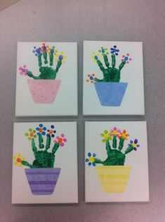 with fingerprint flowers on canvas. Flower pots were cut from scrapboo Handprint with fingerprint flowers on canvas. Flower pots were cut from scrapbooHandprint with fingerprint flowers on canvas. Flower pots were cut from scrapboo Egg Crafts, Baby Crafts, Preschool Crafts, Kids Crafts, Plate Crafts, Mothers Day Crafts For Kids, Spring Crafts For Kids, Flower Pot Crafts, Flower Pots