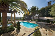 Imagine swaying palm trees, a gorgeous hilltop view, pristine gardens and an inviting swimming pool and you are set for a relaxing day in Santa Barbara! Mark Scott and Associates created an exciting landscape design that harmonizes with all the great features of this home's architecture and its adjacent surroundings. The simple design of the pool and patio help create a serene yet seductive retreat.