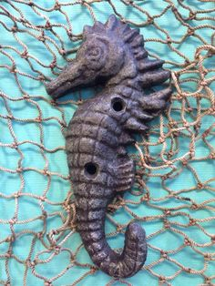 """Seahorse hook Adorable hook, perfect for hanging almost anything ! Made with cast iron , this hook has countless uses Description: Come in brown or rusty green Or Sea Blue 5""""1/12"""" Tall , 2""""3/4"""" Wide *"""