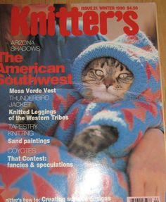 This cat just *loves* its sweater, obviously.