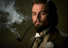 "Leonardo DiCaprio smoking a long-stemmed pipe like a boss in ""Django Unchained.""  Clearly not a kid anymore."