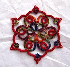 tat-ology: The thread: Krystle's Midsummer Night's Dream, #20, And red #20 Cébélia. The pattern: Sharon's: Merry Christmas Snowflake 2009